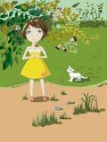Petite fille avec un chat Photographie stock
