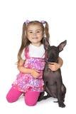 Petite fille avec un chiot Image libre de droits