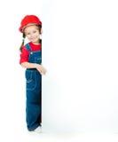 Petite fille avec un panneau blanc photos stock