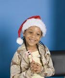 Petite fille avec une canne de sucrerie Image libre de droits