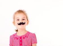 Petite fille avec une moustache Photos stock