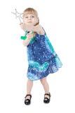 Petite fille blonde avec une baguette magique magique Images libres de droits