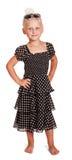 Petite fille blonde dans la robe foncée avec des points de polka photos libres de droits