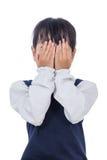 Petite fille chinoise asiatique couvrant son visage images stock
