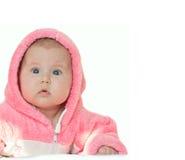 Petite fille dans des combinaisons roses sur un blanc d'isolement Image stock