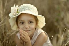 Petite fille dans fied Photos stock