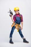 Petite fille dans la ceinture d'outil image libre de droits