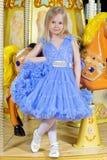 Petite fille dans la robe bleue Images libres de droits
