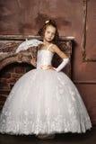 Petite fille dans la robe de mariage Photographie stock libre de droits