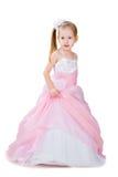Petite fille dans la robe magnifique d'isolement sur le blanc Image stock