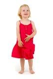 Petite fille dans la robe rouge Photographie stock libre de droits