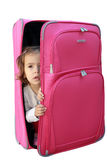Petite fille dans la valise Images stock