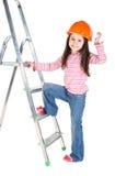 Petite fille dans le casque de sécurité Photo libre de droits