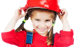 Petite fille dans le casque rouge images stock