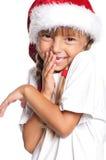 Petite fille dans le chapeau de Santa Image stock