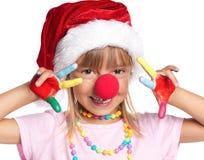 Petite fille dans le chapeau de Santa Photographie stock