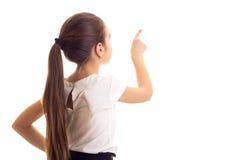 Petite fille dans le T-shirt blanc et la jupe noire image stock