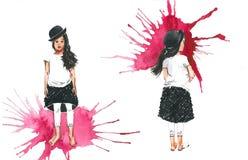 Petite fille dans un chapeau noir Photo stock