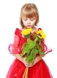 Petite fille dans une robe de boule rouge Image stock