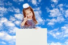Petite fille dans une robe rayée images stock