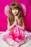 Petite fille dans une robe rose photographie stock libre de droits