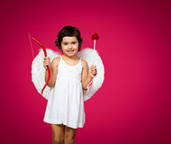 Petite fille de cupidon Photo stock