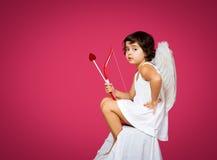 Petite fille de cupidon Photographie stock libre de droits
