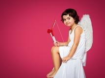 Petite fille de cupidon Images stock