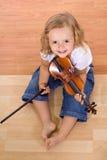 Petite fille de musicien photographie stock libre de droits