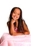 Petite fille de sourire avec des tresses Images stock