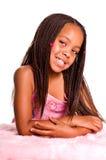 Petite fille de sourire avec des tresses Photos stock