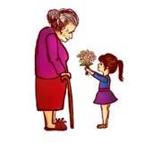 Petite-fille donnant des fleurs à la grand-mère Images libres de droits