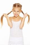Petite fille drôle avec des tresses Images stock