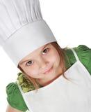Petite fille en chef de cuisinier Photos libres de droits