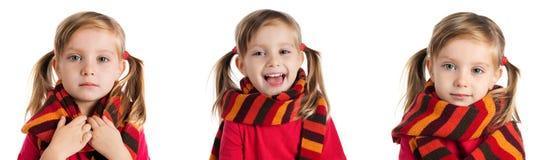 Petite fille en photos rayées d'une écharpe Photos stock
