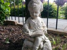 Petite fille en pierre Images libres de droits