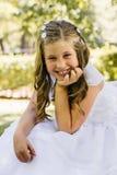 Petite fille en son premier jour de communion Images stock