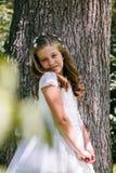 Petite fille en son premier jour de communion Photographie stock