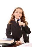 Petite fille en tant que femme réfléchie d'affaires Image stock