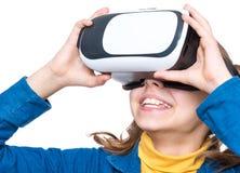 Petite fille en verres de VR Photographie stock libre de droits