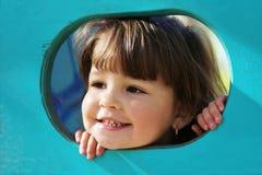 Petite fille espiègle mignonne Photographie stock