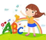 Petite fille et ABC Photos stock