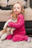 Petite fille et chat Image stock