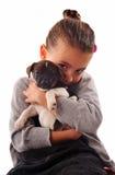 Petite fille et chiot Photo stock