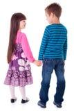 Petite fille et garçon tenant des mains Images stock