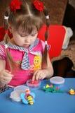 Petite fille et pâte à modeler Photos libres de droits