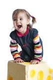 Petite fille gaie sur un fond blanc Images stock