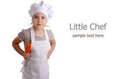Petite fille habillée en tant que cuisinier photo stock