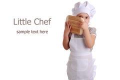 Petite fille habillée en tant que cuisinier image stock