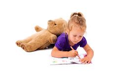 Petite fille heureuse avec le cahier Image stock